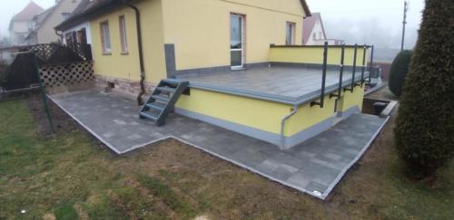Terrasse in Graniteinfassung  Erneuerung Garagenfassade 3